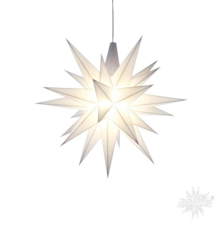 Weißer geometrischer Stern aus Papier gefallen mit einem integrierten Leuchtmittel.