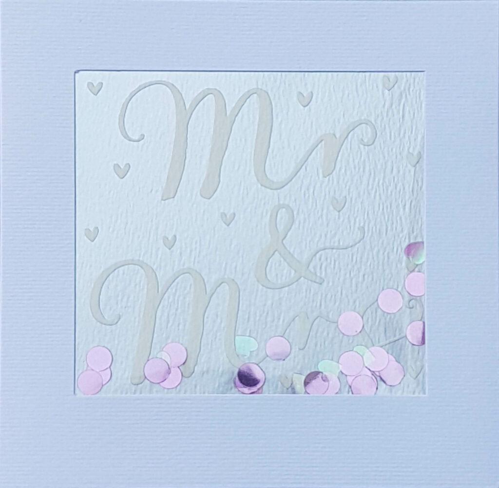 """Grußkarte """"Mr & Mrs"""" mit glitzerndem Konfetti."""