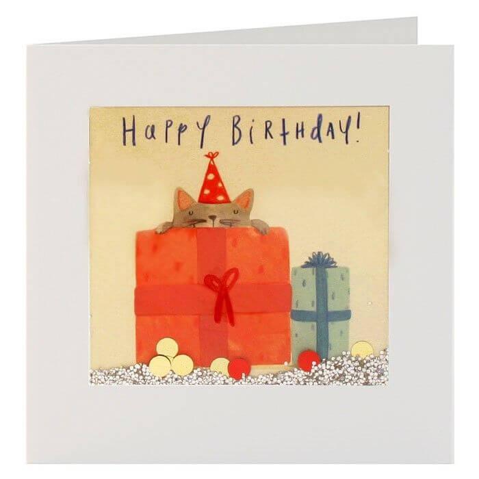 """Grußkarte """"Happy Birthday"""" mit einer Katze im Geschenkpaket."""