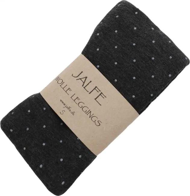 Freisteller von Woll-Leggings in dunkelblau mit weißen Punkten.